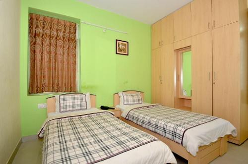 Service apartments in AECS Layout, Bangalore - Deluxe Bedroom