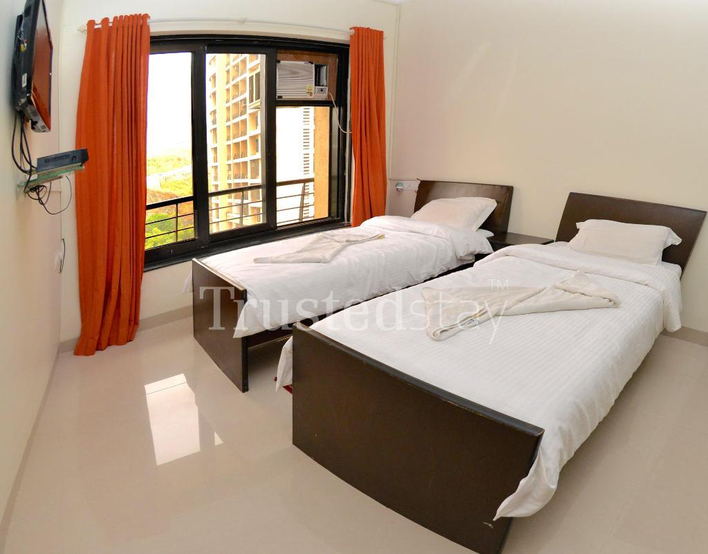 Service Apartments in Malad East, Mumbai - Master Bedroom