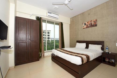 Service Apartments in Kopar Khairane, Mumbai | Bedroom
