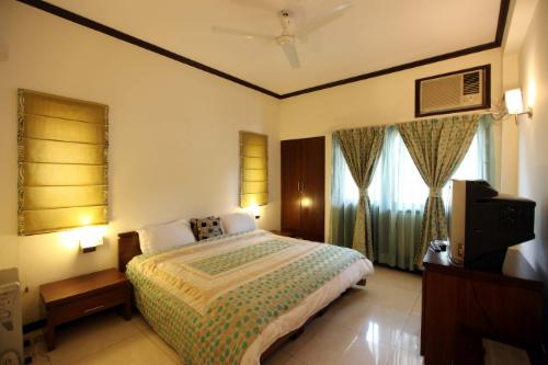 Qualified Service apartment in Delhi - Master bedroom